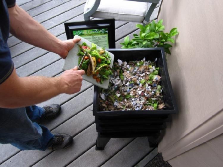 man dropping greens into the bin