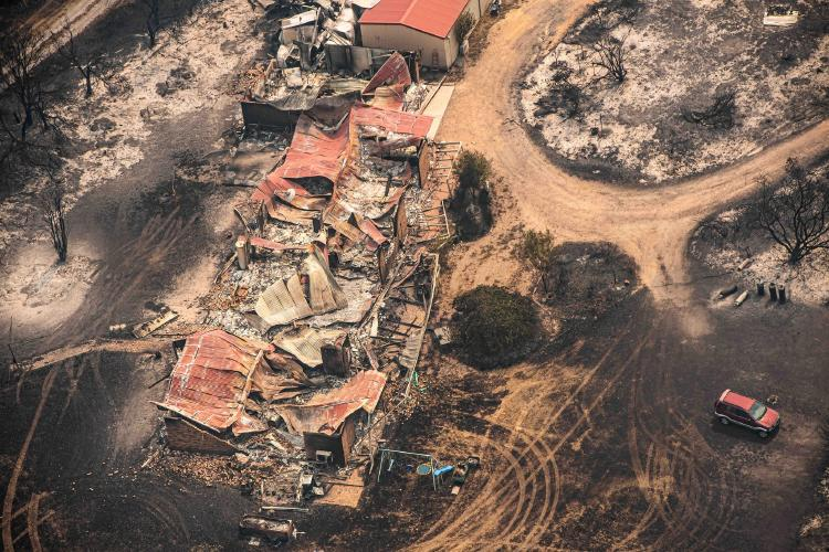 from above a house torn down by flames