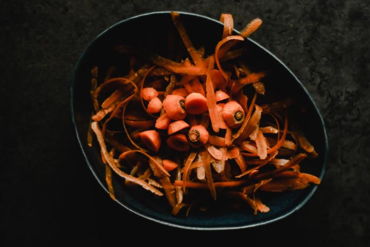 carrot peels in a bin