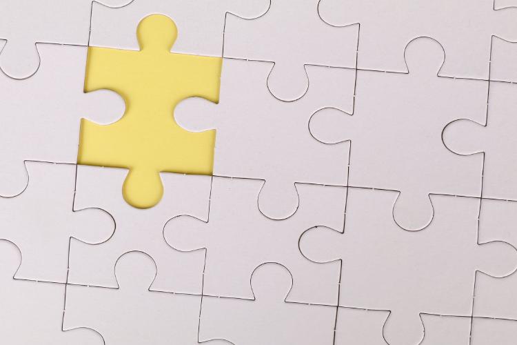 yellow jig saw puzzle piece