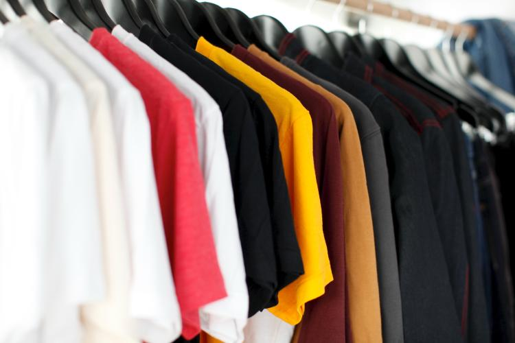 A rack of t shirts