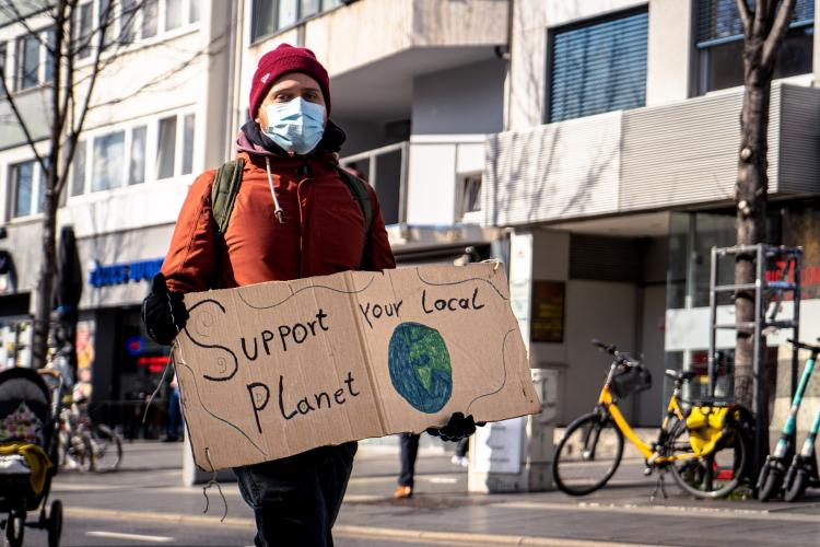 A man holding a banner for climate change