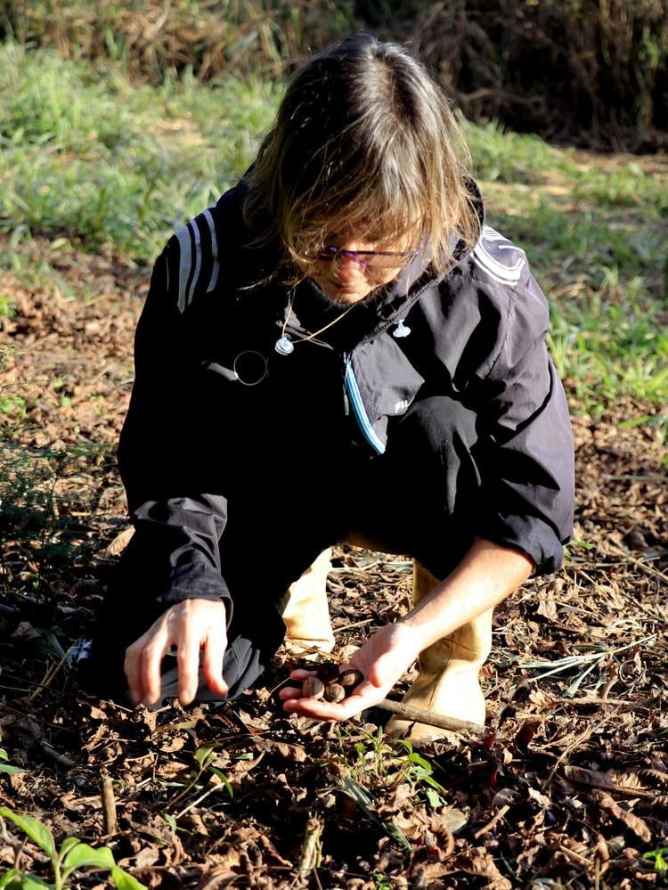 Woman checking soil with hands