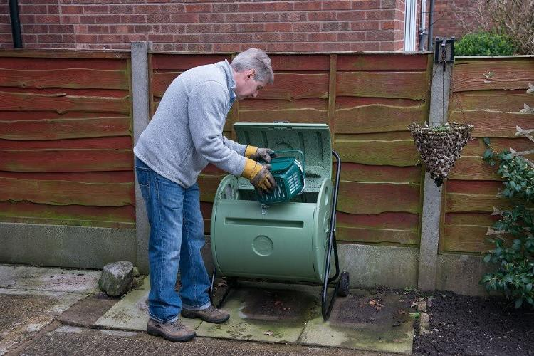 Man filling the composter
