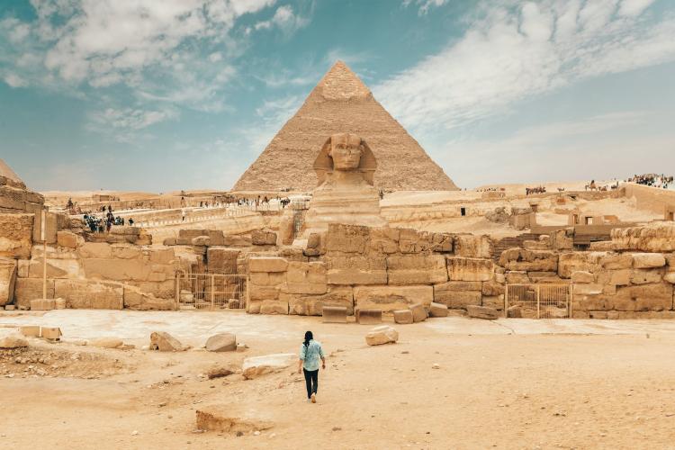 tourist walking towards the great pyramid of Giza