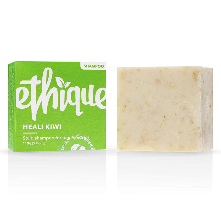 The Ethique Vegan Shampoo Bar next to its green packaging
