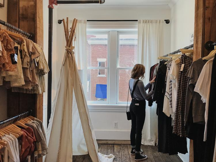 Woman shopping on a second-hand clothing store