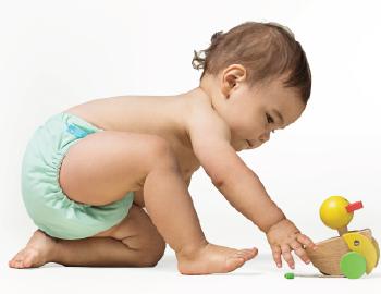Baby wearing a Charlie Banana Diaper