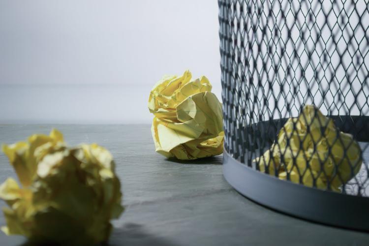 yellow paper rolls in a bin