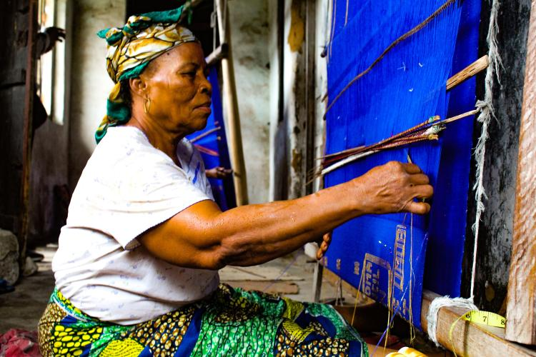 a woman with a loom