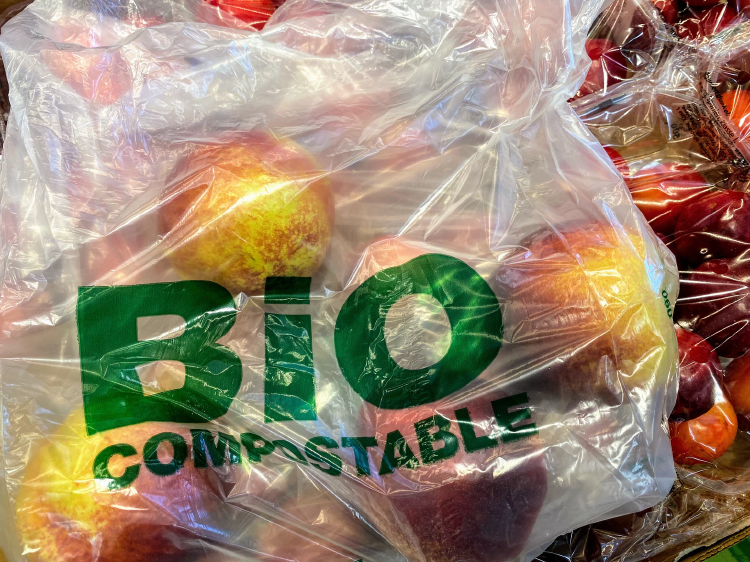 compostabe bag filled with red apples