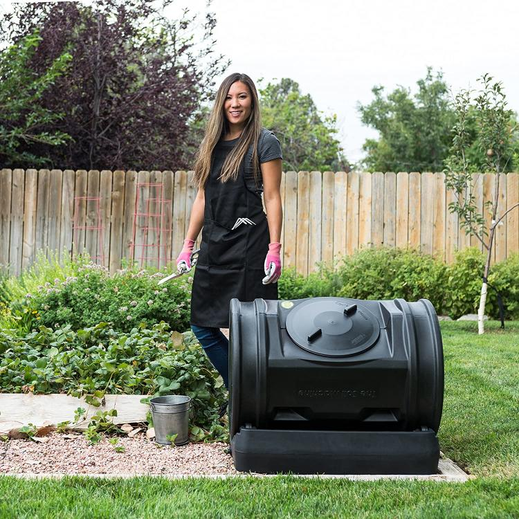 Woman doing some gardening next to the composter