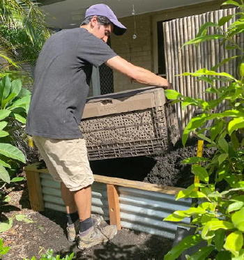 Man installing composter