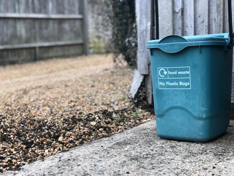 a compost bin in a yard