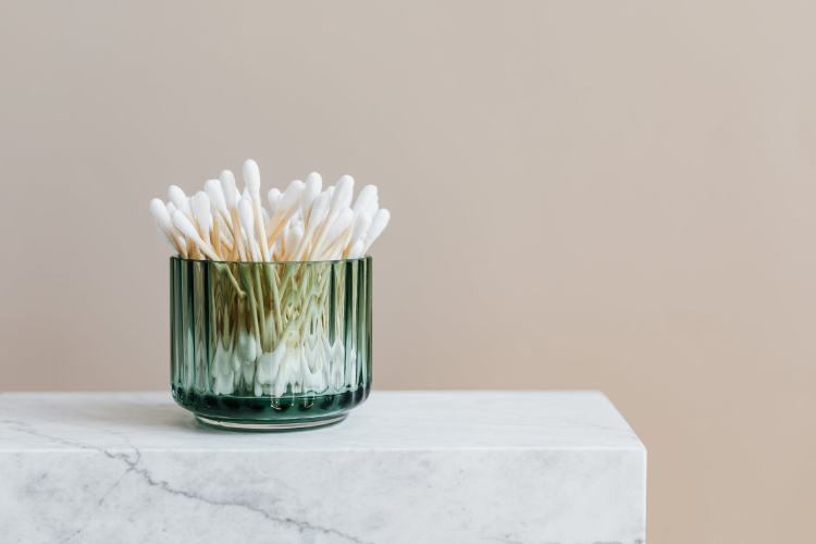 photo of white cotton buds with non-plastick stick in a green vase