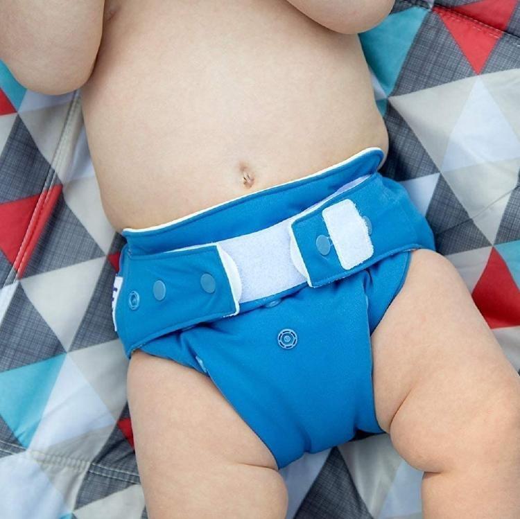 A baby wearing a GroVia O.N.E. Cloth Diaper
