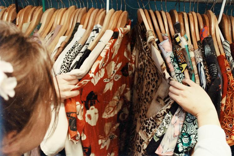 a woman browsing in a thrift store