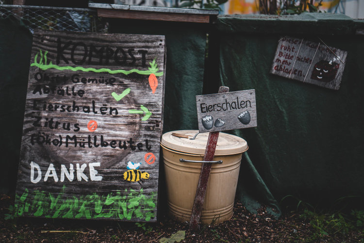 compost bin with signs in German