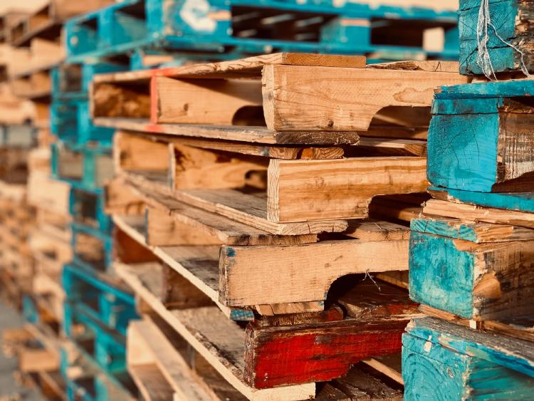 Pile of pallets of different colors