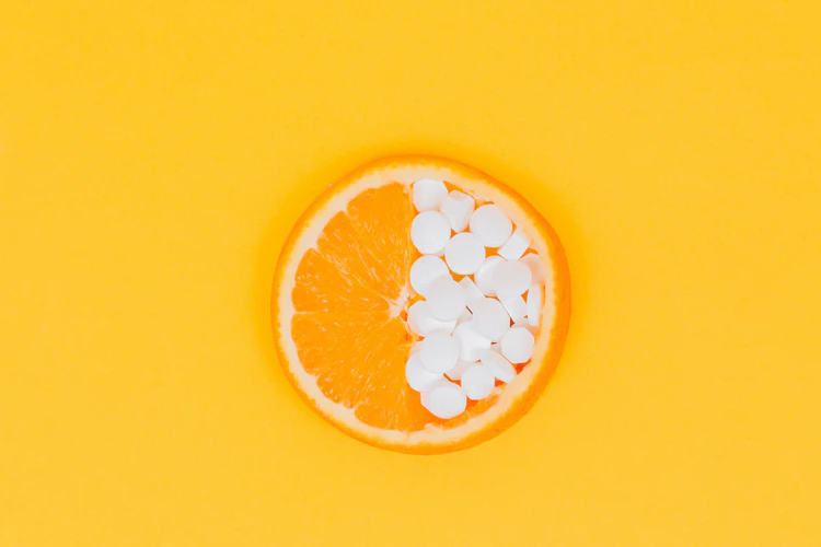 vitamins on a yellow, orange background
