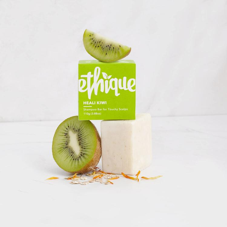The Ethique packaging on top of the Ethique shampoo bar, decorated with kiwis