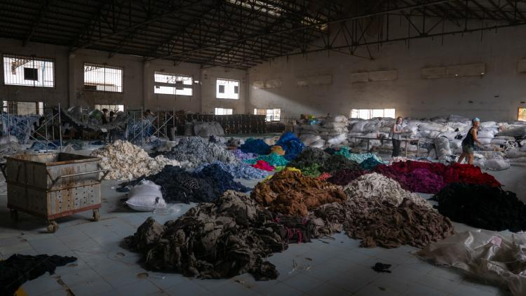 piles of different color fabrics