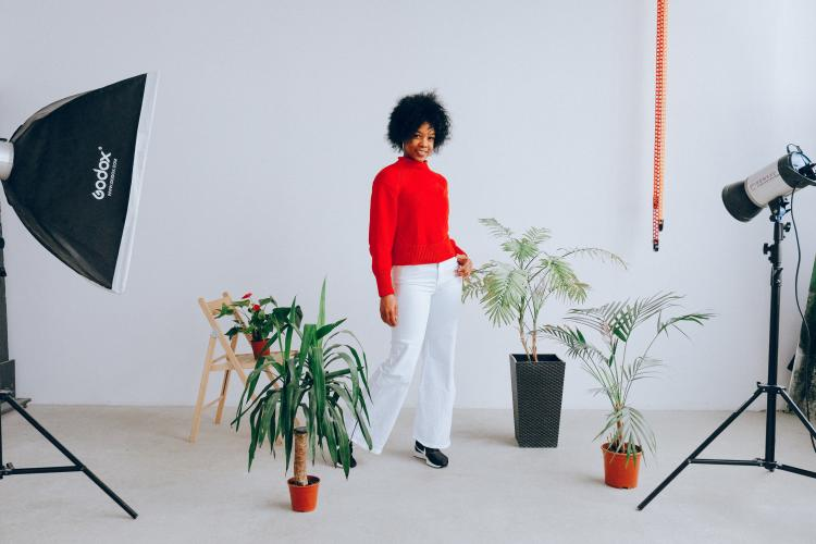 a woman being photographed with plants