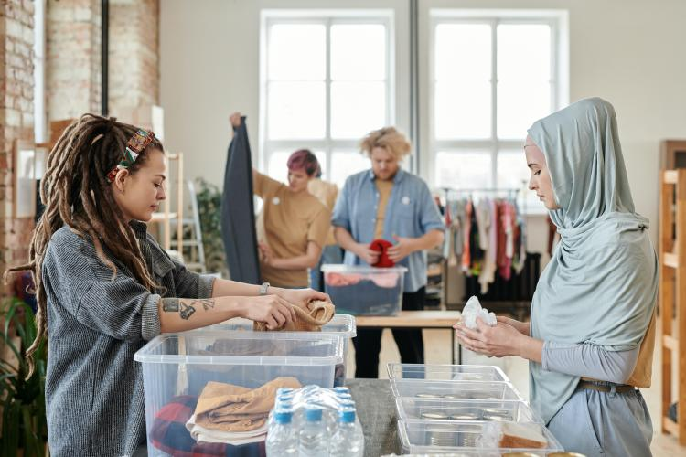 two women sourcing clothes to be recycled