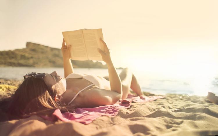 woman-lying-on-beach