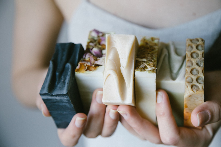 person holding soap bars with their hands