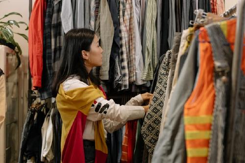 Woman shopping secondhand clothes