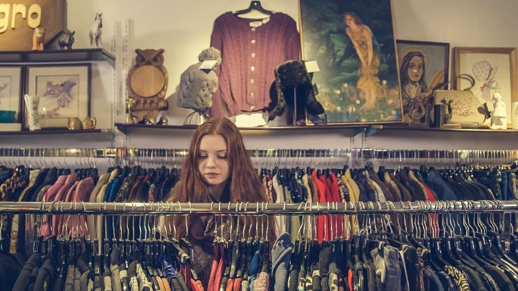 Girl in a second hand clothing shop