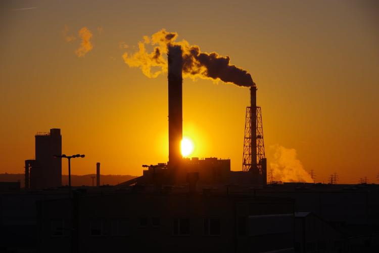 smoking towers during sunset