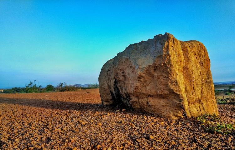 Rock by the road