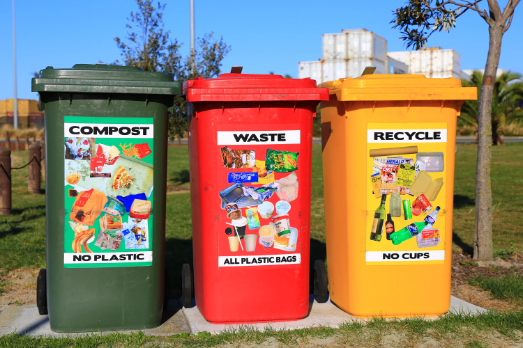 green, red and yellow compost bins