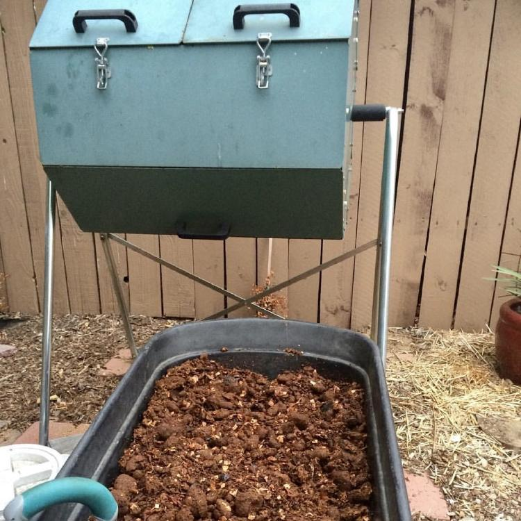 Mature compost in front of the Jora Composter