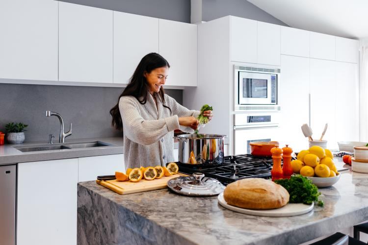 a woman cooking a plant based food