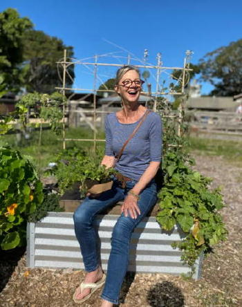 woman sitting on composter