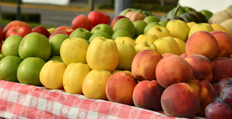 red and green apples, plump and peaches on market